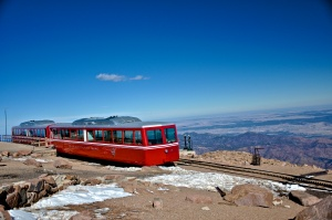 The Cog Train waits while its passengers gouge themselves on mountain donuts...